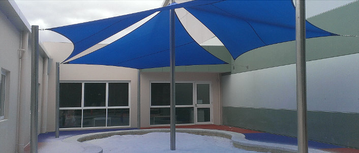 Shade sails over swimming pool area image
