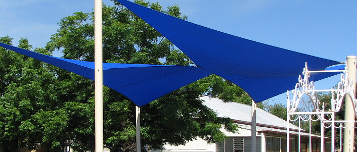 Twin blue sails over garden image